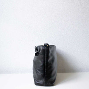 A black leather bag from the left.