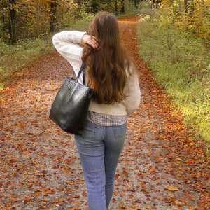 A woman walking in the forest in autumn.