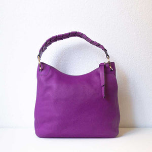 A magenta handbag from the back.