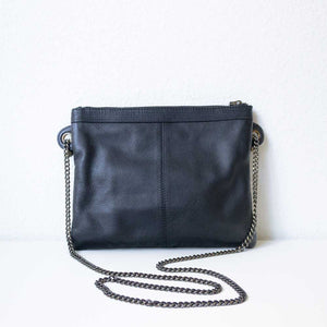 A black studded pouch from the back.