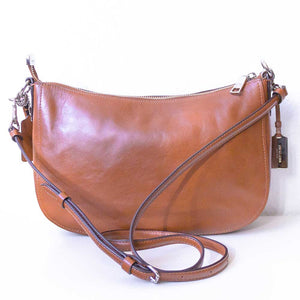 A camel Coach bag from the back.