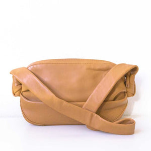 A camel shoulder bag from the back.