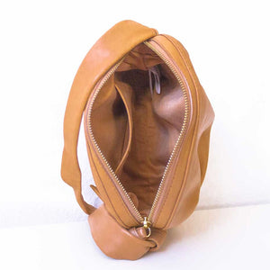 A camel shoulder bag from inside.