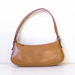 A camel baguette vintage bag from front.