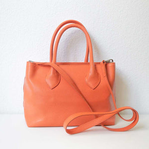 An orange handbag from the back.