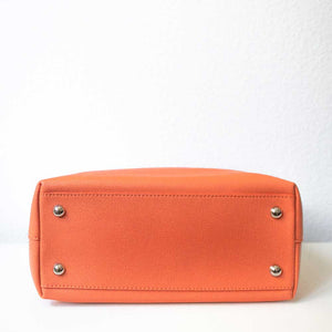 An orange handbag from under.