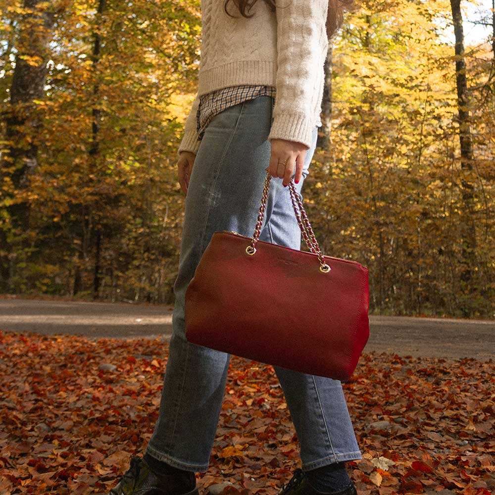 A woman walking in the forest in fall.