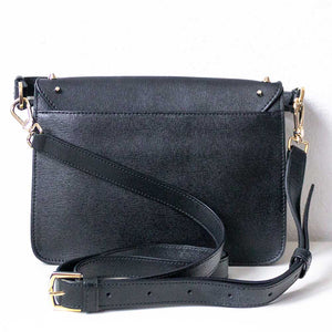 A black studded bag from the back.