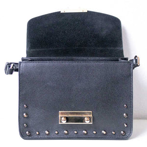 A black studded bag open.