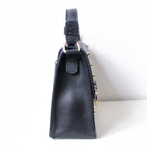 A black studded bag from right.