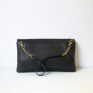 A golden eyelets pouch from the back.
