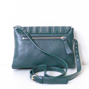 A green crossbody bag from the back.