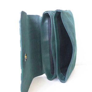 A green crossbody bag from inside.