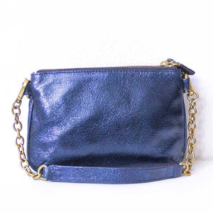 A metallic blue pouch from the back.