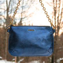 Laden Sie das Bild in den Galerie-Viewer, A metallic Fossil blue pouch.