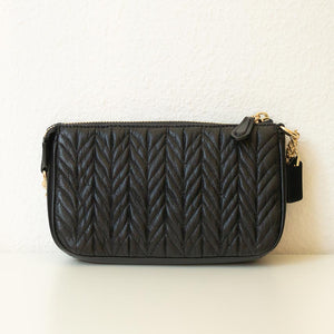 A black quilted pouch from the back.