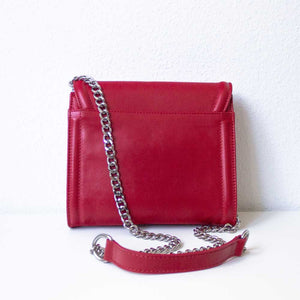 A red cross body bag from the back.