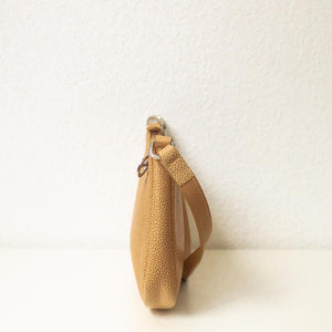 A camel baguette bag from left.