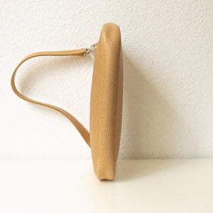 A camel baguette bag from under.