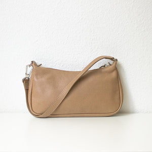 A Longchamp beige baguette bag from the back.