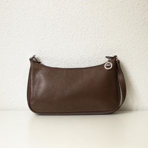 A brown Longchamp baguette bag from the back.