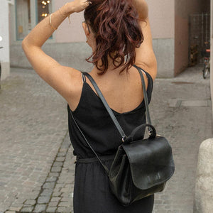 A woman doing her hair while walking.