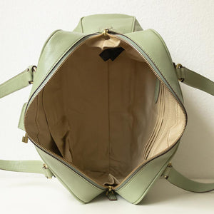 A pistachio green handbag from inside.