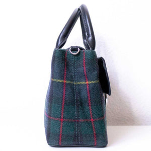 A tartan handbag from left.