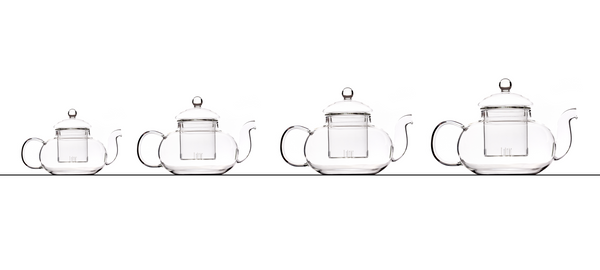 Picture of 4 glass teapots in a row with glass filter and glass top