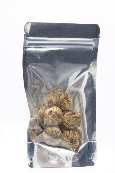 Clear back resealable pack with 5 balls of Blooming Tea