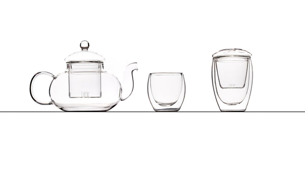 Picture of our Glass Teapot with glass filter and glass top next to our 80 millilitre doubled walled glass cup and our 350 millilitre double walled glass cup with glass filter and glass saucer