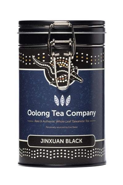75 grams of Jinxuan Black loose leaf high mountain Oolong tea from the Nantou county of Taiwan in a round black tea caddy with an easy opening silver clip