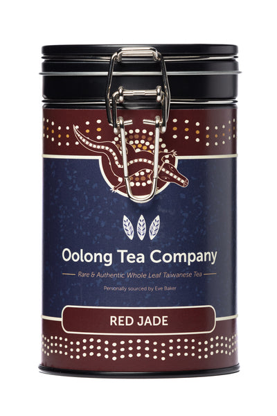75 grams of Red Jade also known as number 18 loose leaf high mountain Oolong tea from the Nantou county of Taiwan in a round black tea caddy with an easy opening silver clip