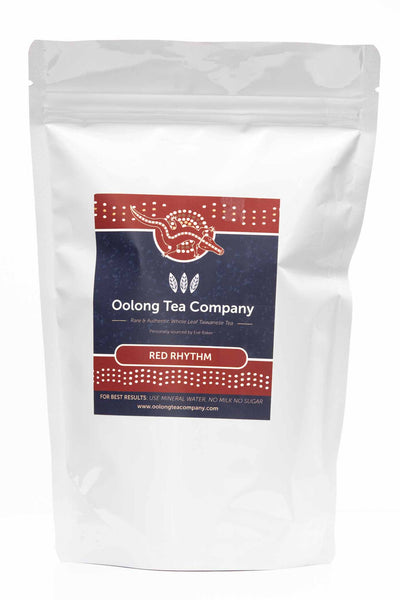 100 grams of black Loose leaf Red Rhythm also known as number 21 high mountain Oolong tea in a white resealable refill pack with one window side