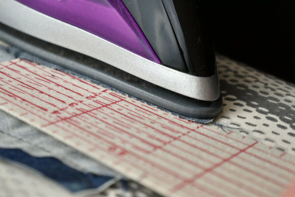Pressing seams with a hot iron ruler