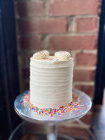 Load image into Gallery viewer, Vanilla cake with buttercream frosting.