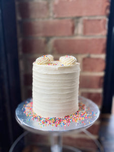 Vanilla cake with buttercream frosting.