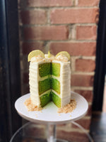 Load image into Gallery viewer, Key lime cake with lime cream cheese frosting.