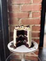 Load image into Gallery viewer, Vegan Oreo cake with vegan buttercream frosting.