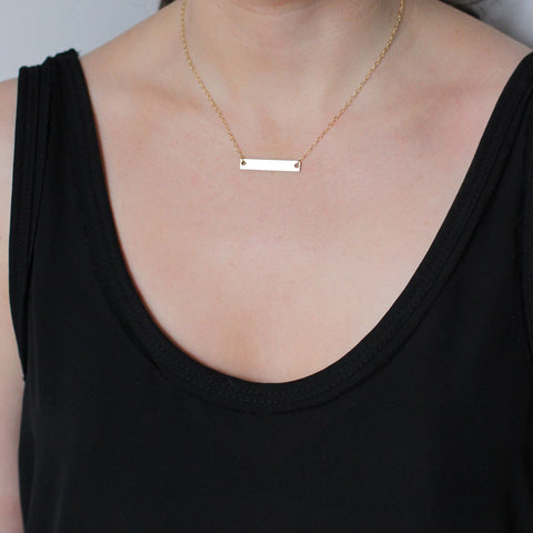 Gold Bar necklace pictured on model