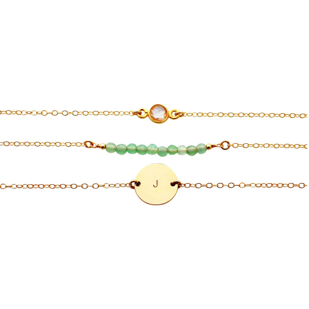 Delicate gold gemstone bracelet set