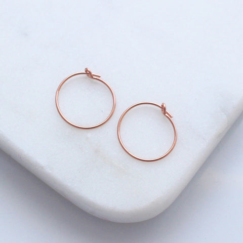 Tiny rose gold hoop earrings