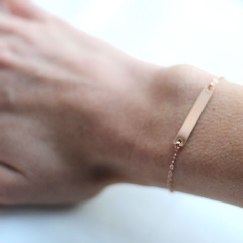 Rose Gold Name Plate bracelet pictured on model