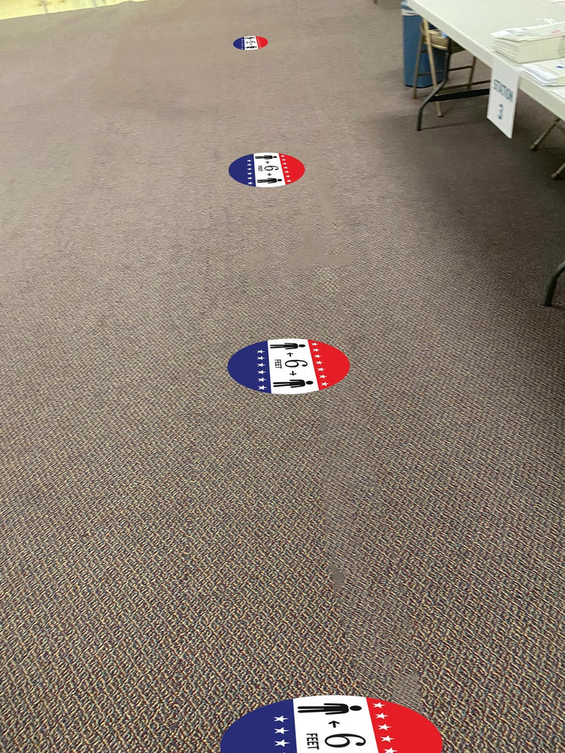 Red, White and Blue Stacked Arrows & People Round Floor Sign