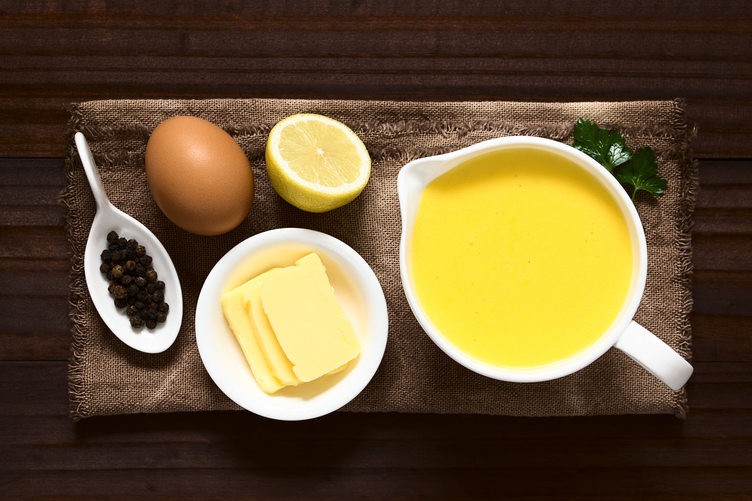 Mother Sauces - Hollandaise Sauce on wooden plank with ingredients