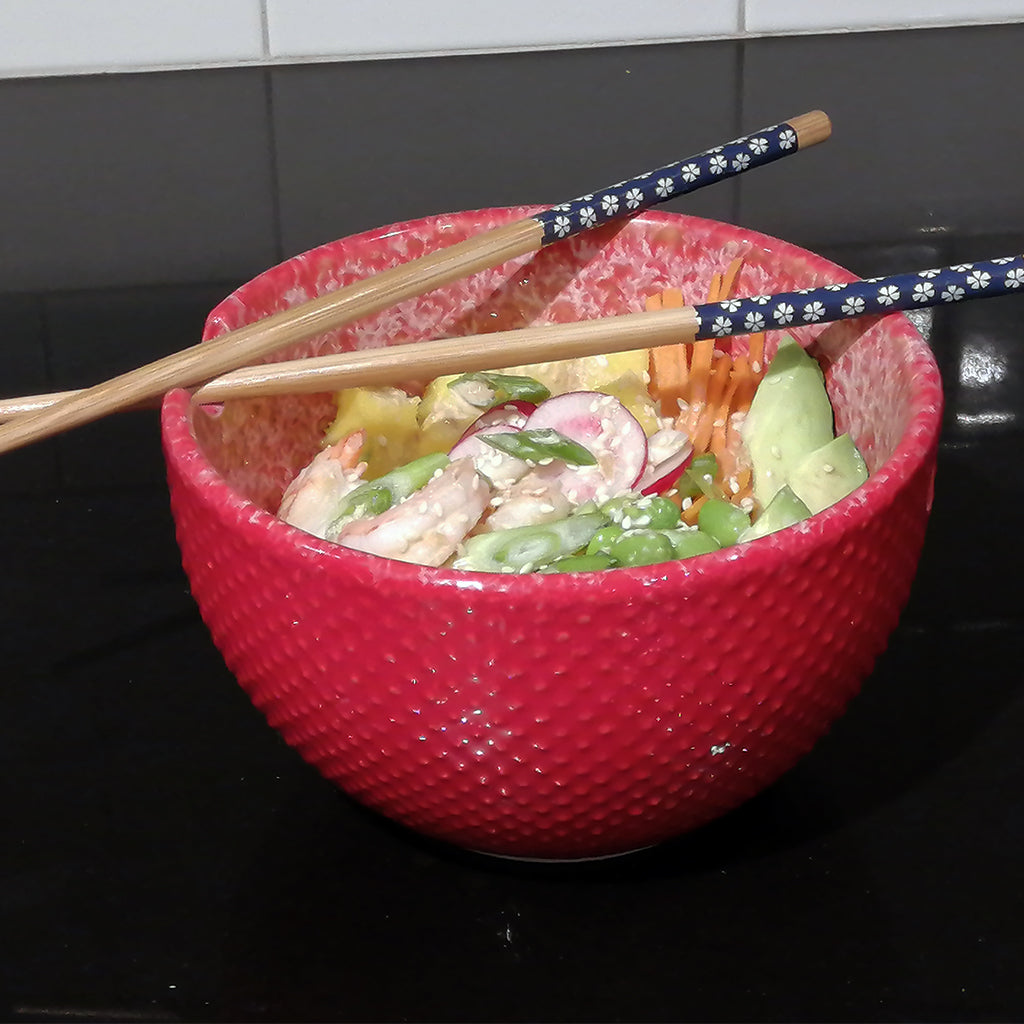 Shrimp Poke Bowl in a red bowl with chopsticks