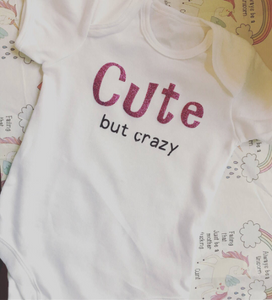 """Cute but crazy"" baby grow"