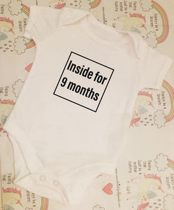 """Inside for 9 months"" baby grow"