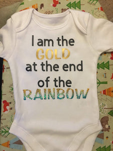 """Gold at the end of the rainbow"" baby grow"