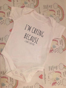 """I'm crying because I don't like you"" baby grow"